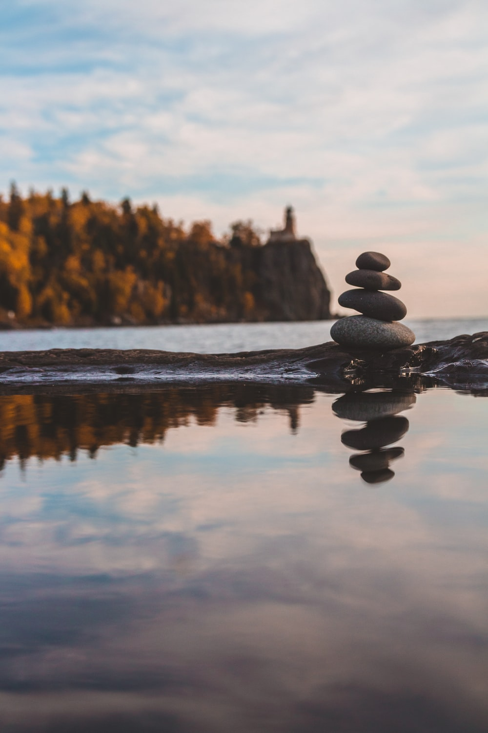 black stone on body of water during daytime