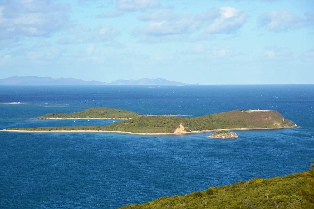 green island under blue sky during daytime