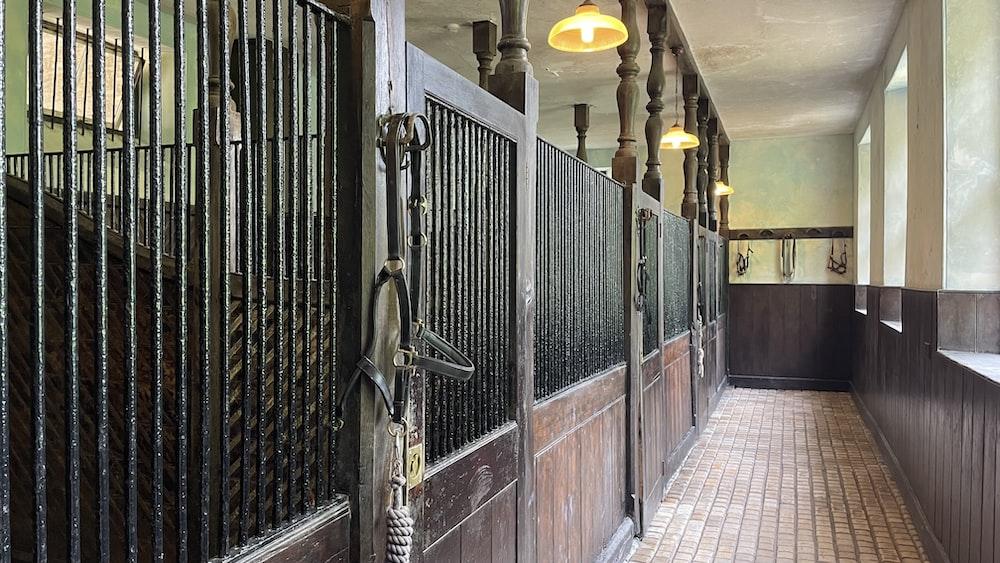 black metal gate on brown brick wall