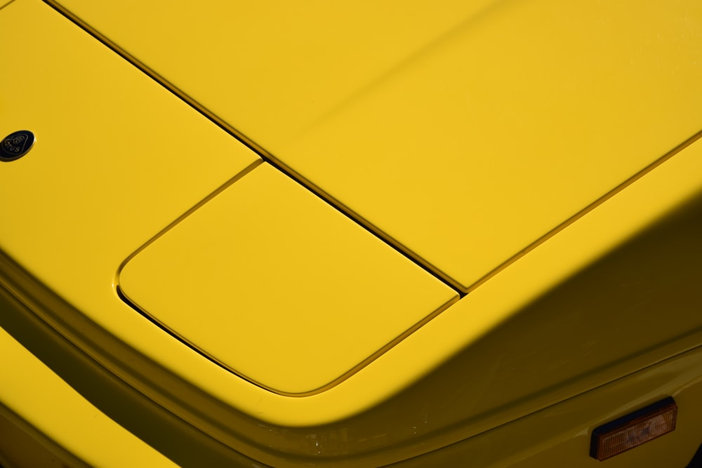yellow and black plastic container