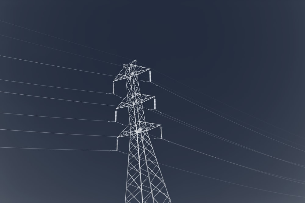 black electric tower under gray sky