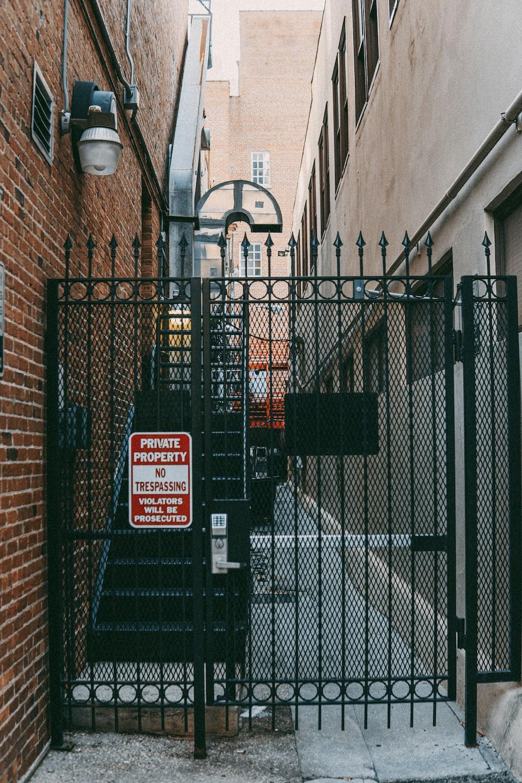 black metal gate with no smoking sign