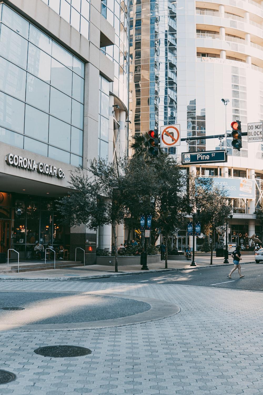 people walking on pedestrian lane near white concrete building during daytime