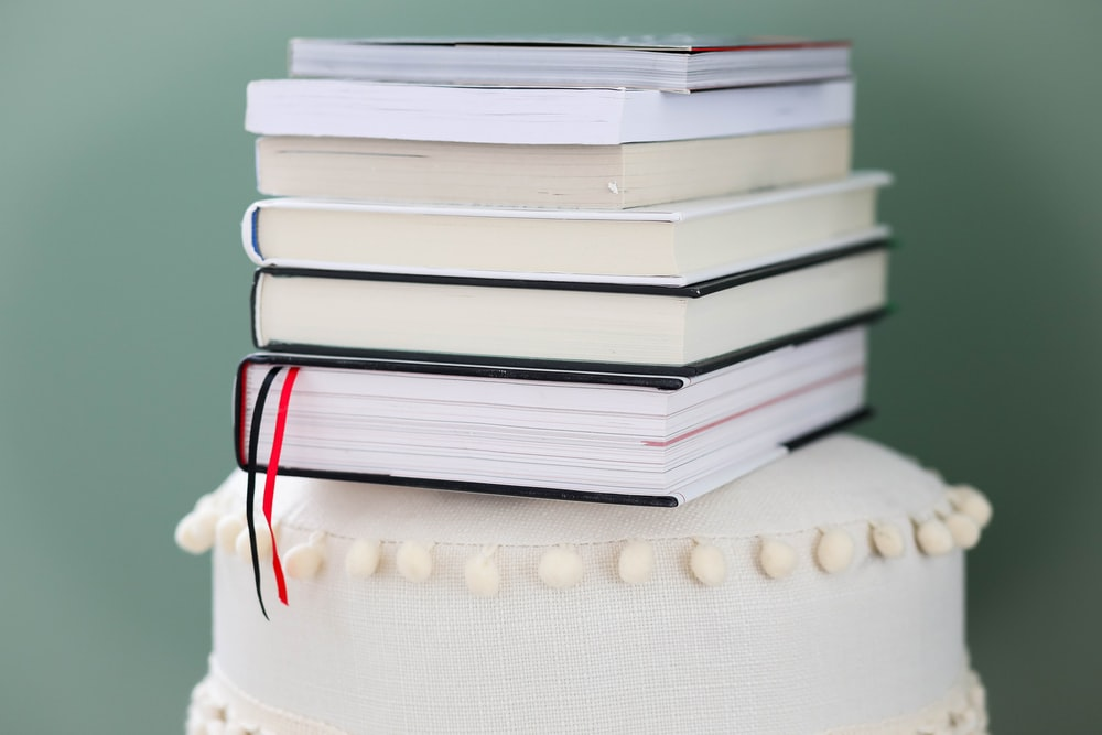 stack of books on white round table