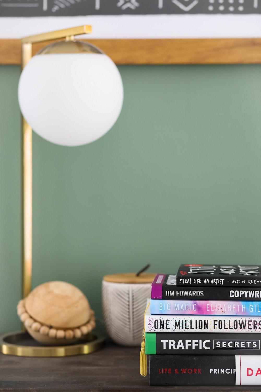 white round lamp near brown wicker basket