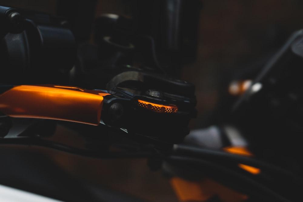 black and orange bicycle handle bar
