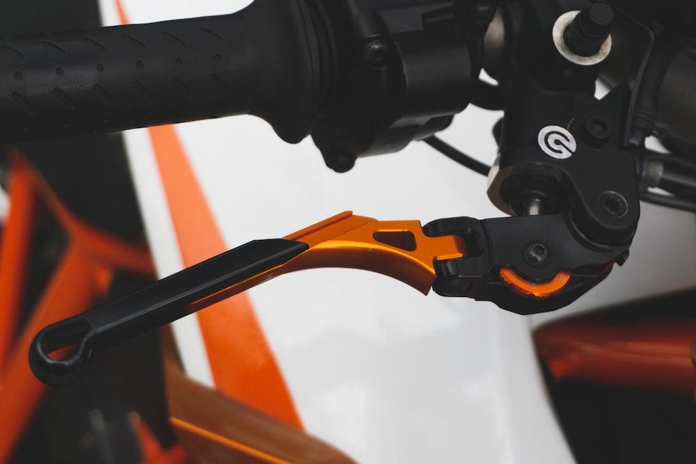 black and orange metal pipe