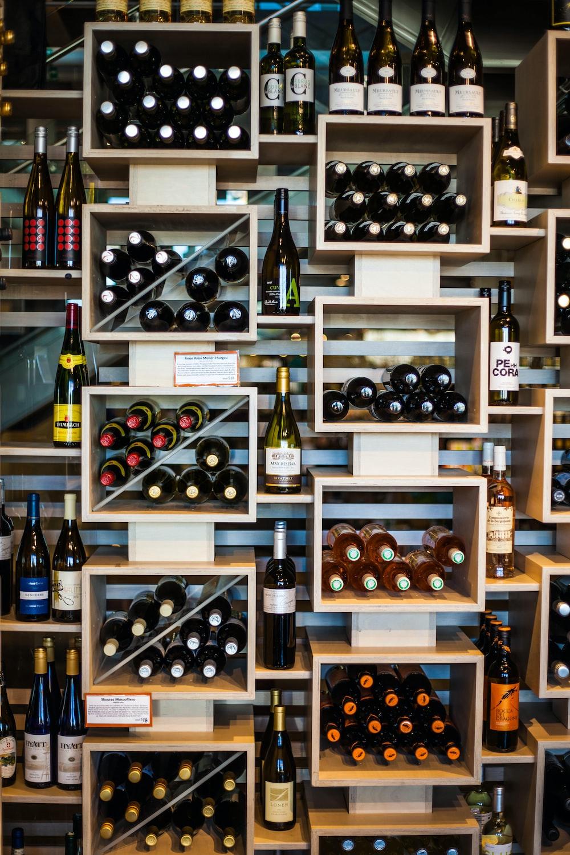 wine bottles on brown wooden shelf