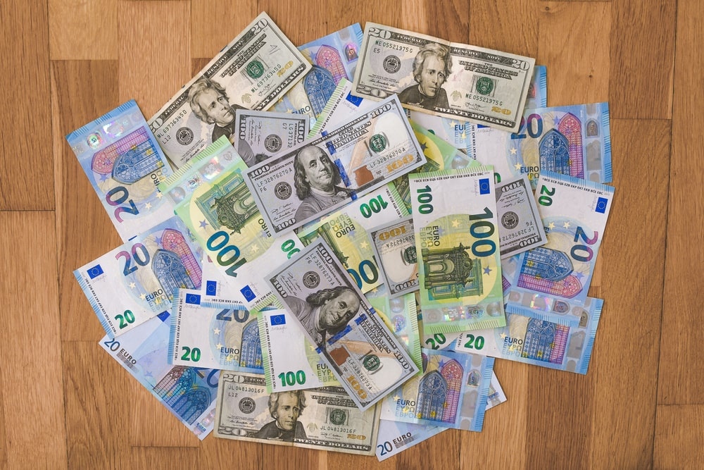 10 and 5 banknotes on brown wooden table