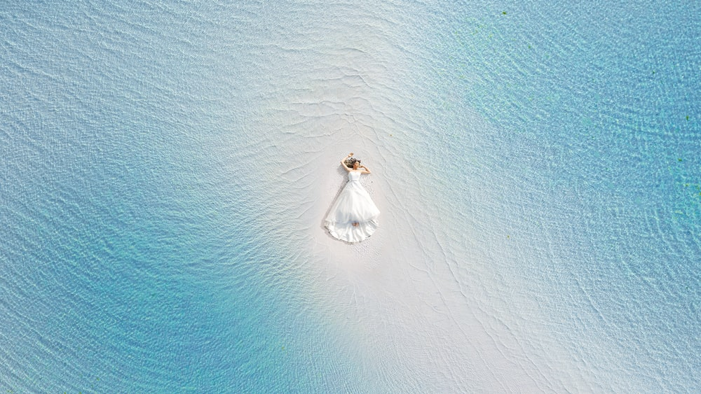 aerial view of white boat on sea during daytime