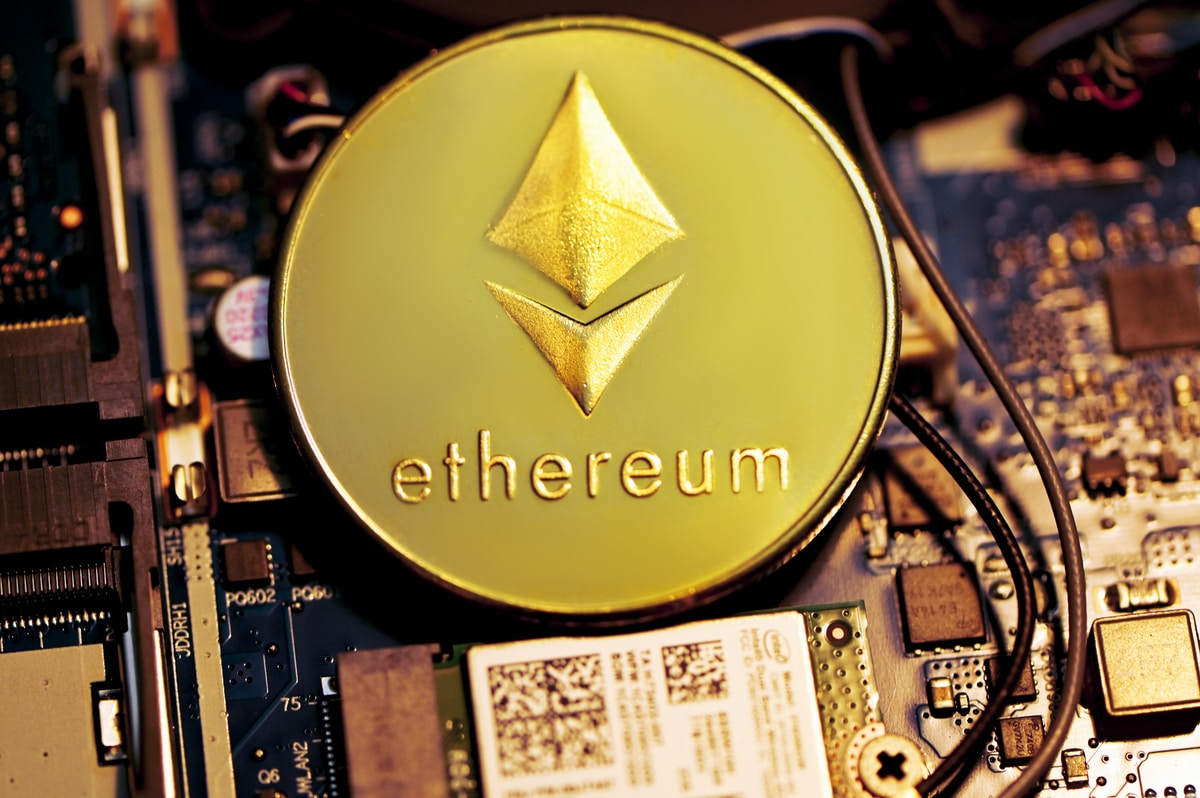 An Ethereum coin placed on a computer mainboard