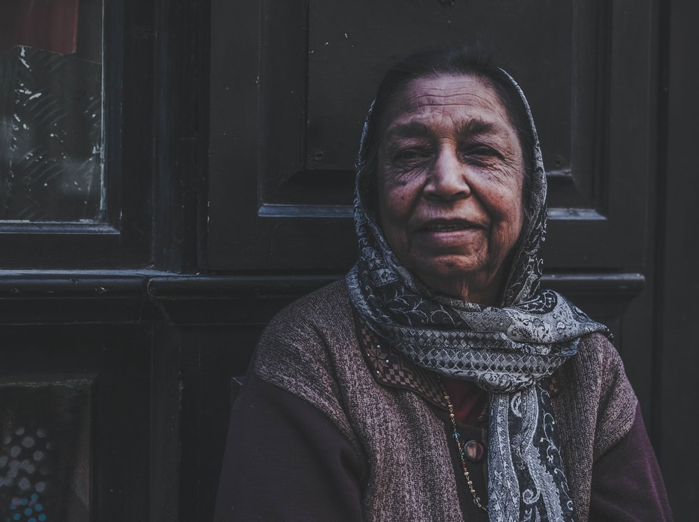 woman in gray and black scarf