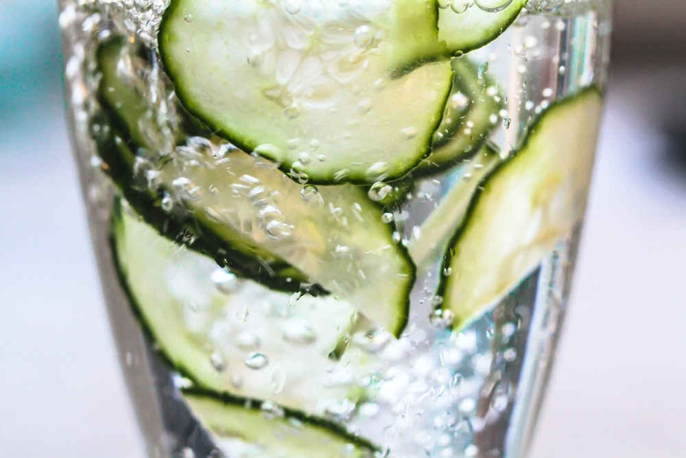 green vegetable on clear glass container