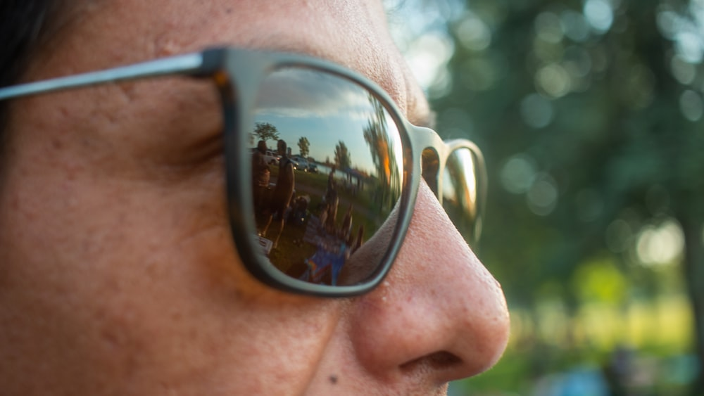 person wearing black framed sunglasses
