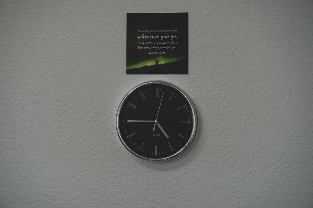 black and green wall mounted analog clock