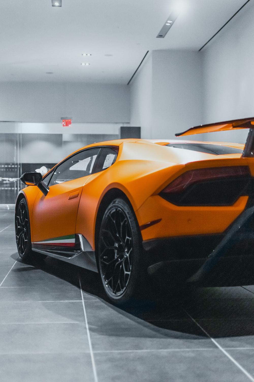 orange lamborghini aventador parked inside building