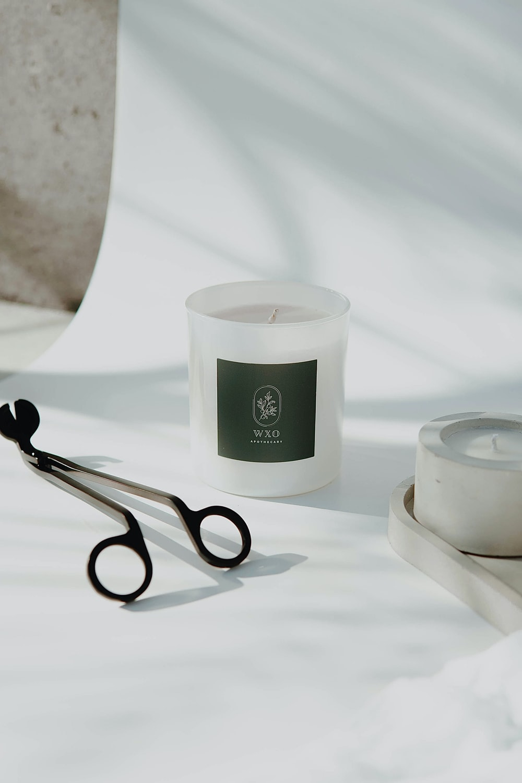 black and silver scissors beside white ceramic round bowl