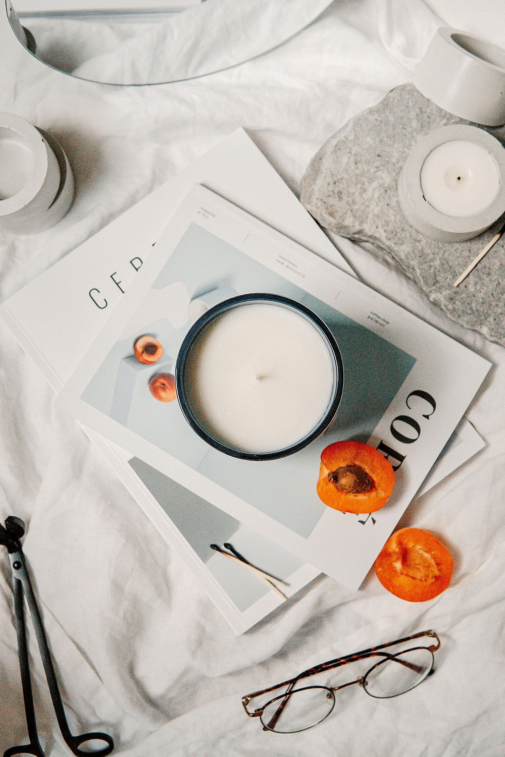 white ceramic cup with saucer on white paper
