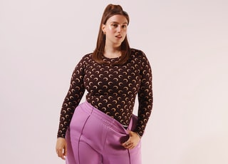 woman in black and white polka dot long sleeve shirt and pink pants