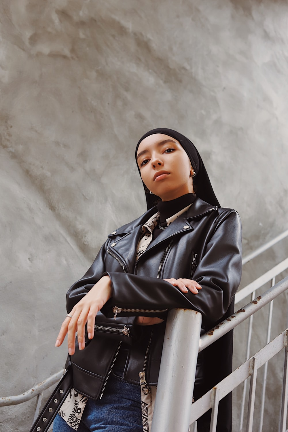 woman in black leather jacket and black hijab