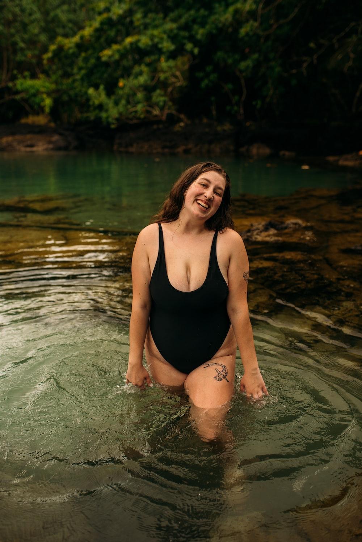 woman in black one piece swimsuit in water