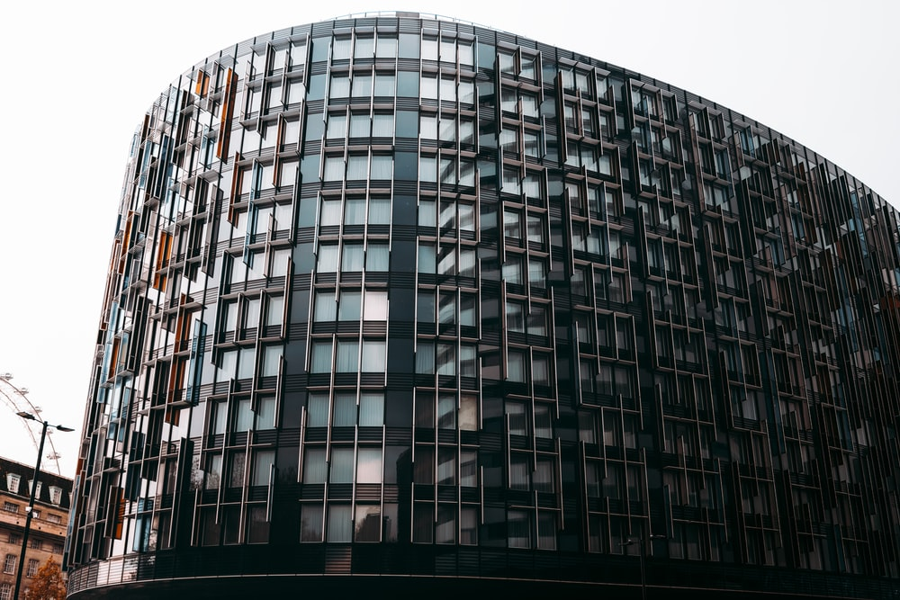 black glass walled high rise building