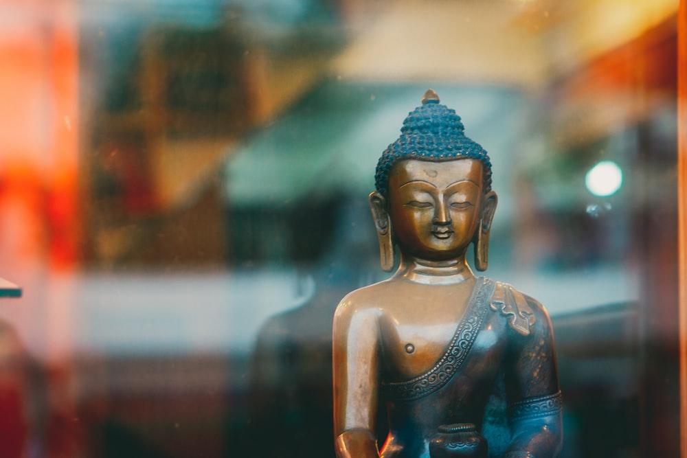 blue buddha figurine in tilt shift lens