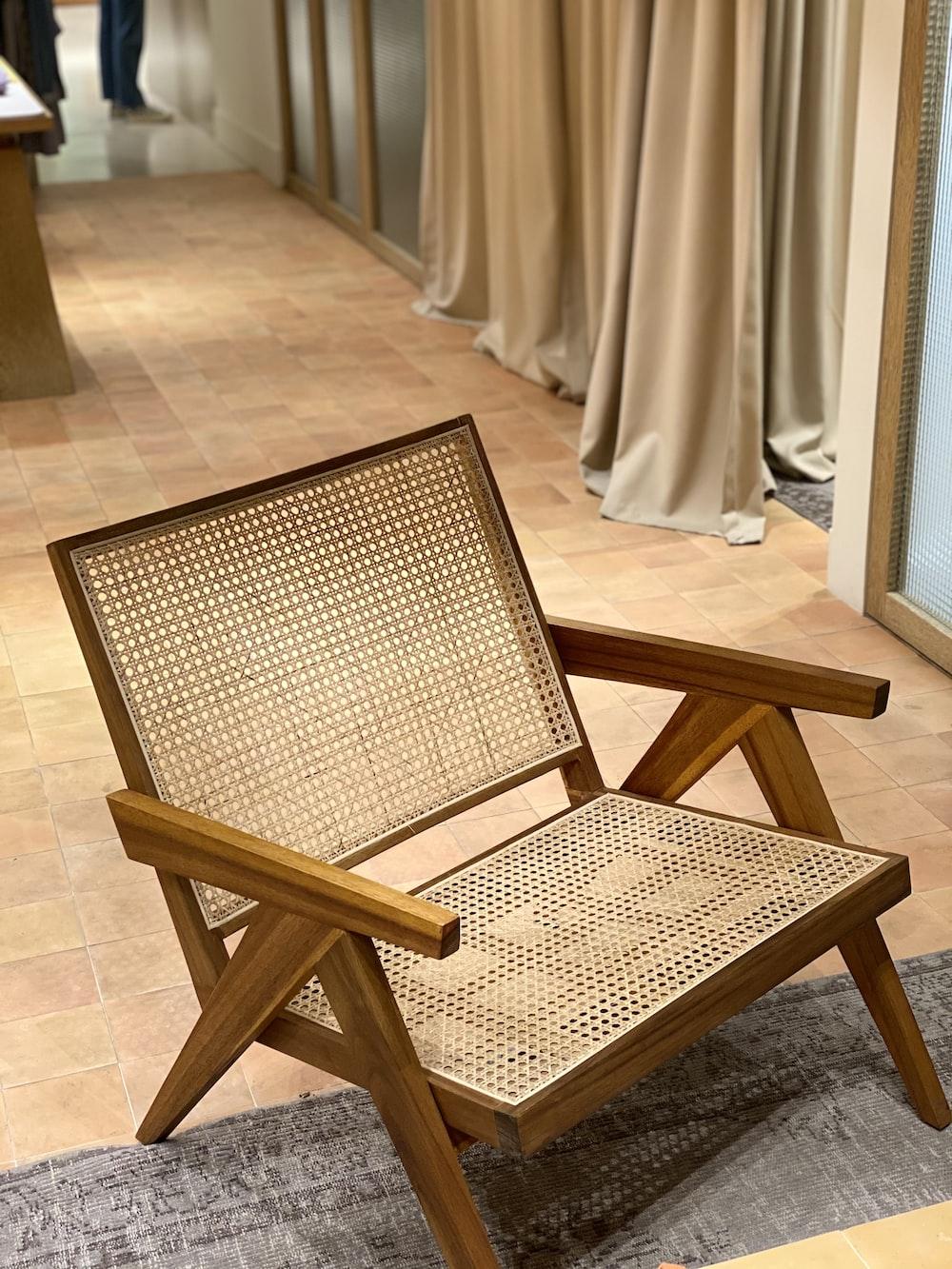 brown wooden chair near white curtain