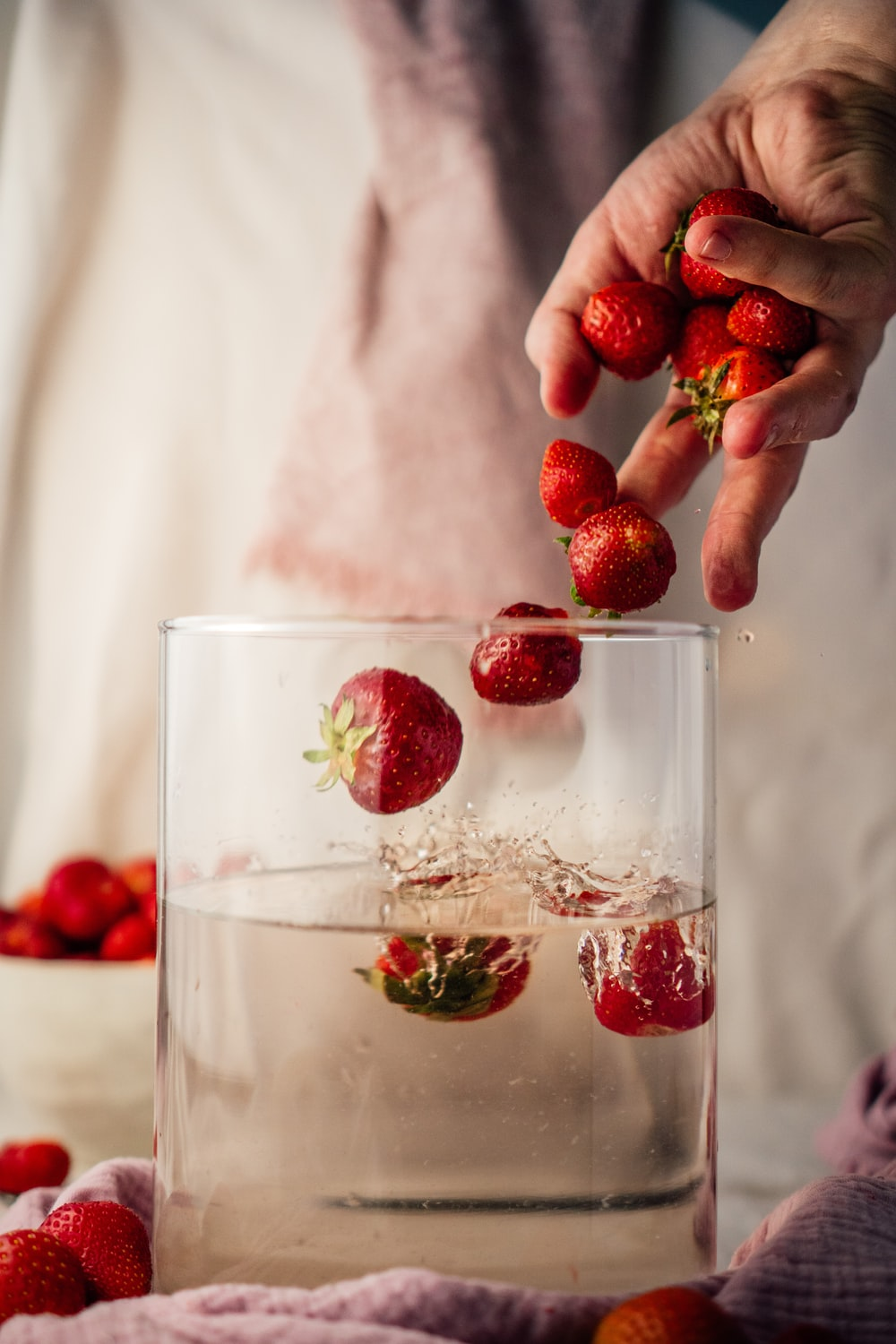 red strawberries in clear drinking glass