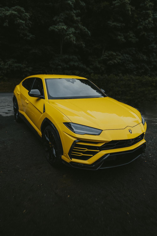 yellow chevrolet camaro on black asphalt road
