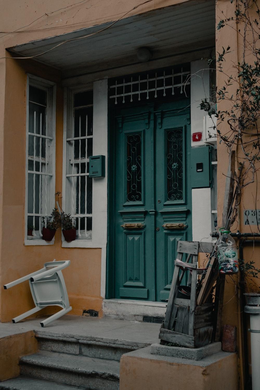 blue wooden door beside brown tree