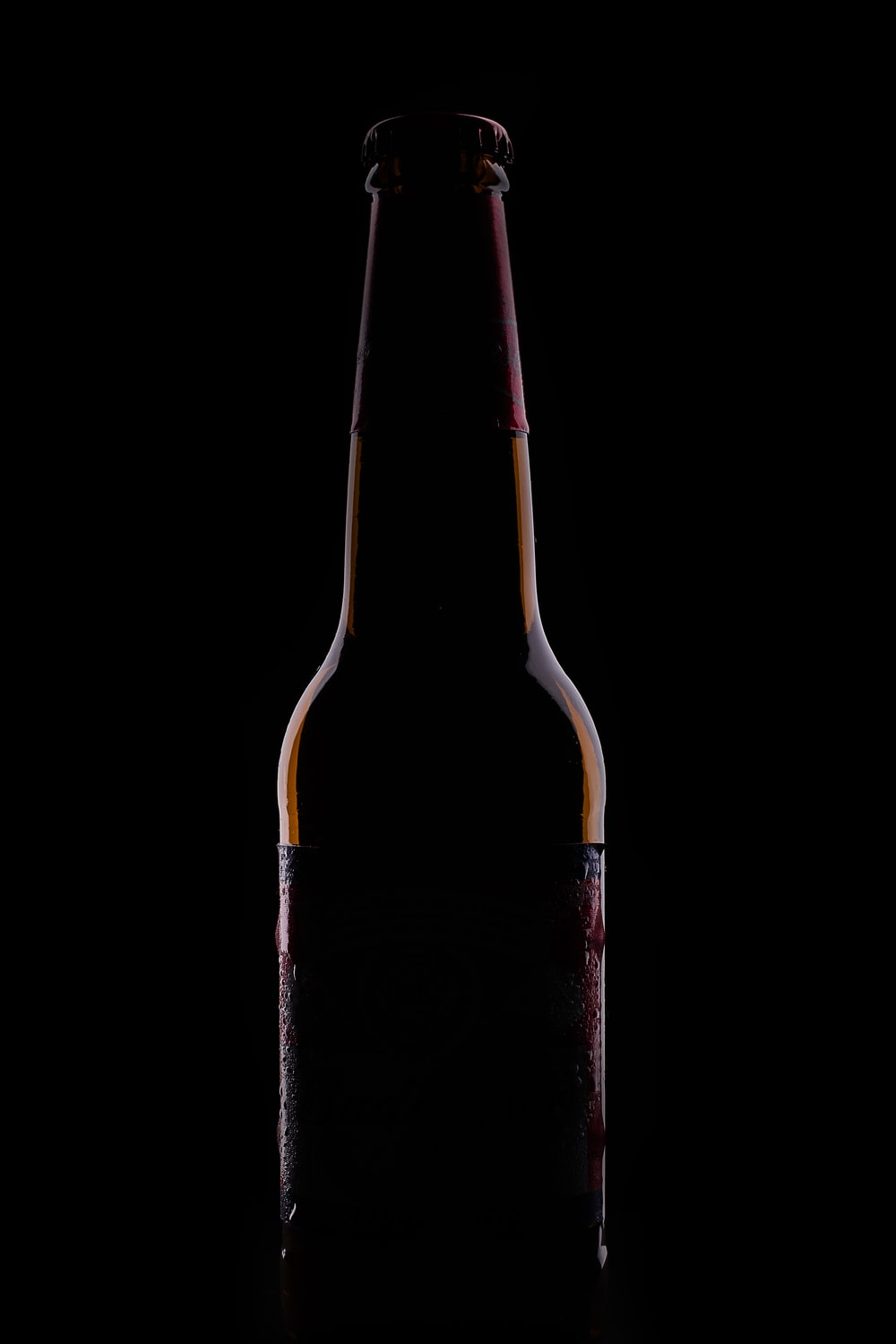 black glass bottle with white background