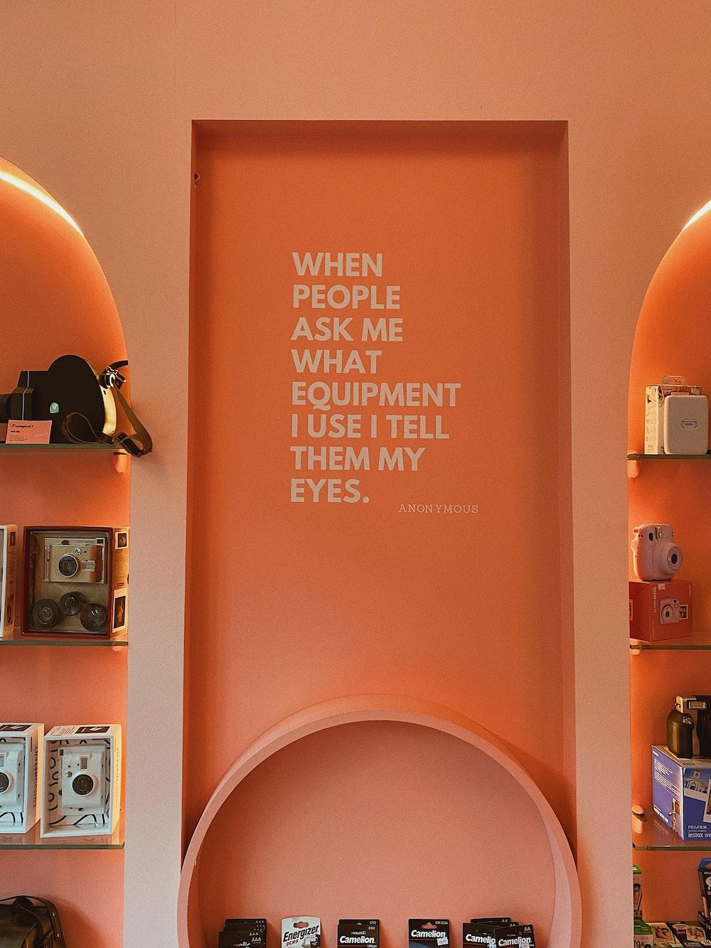 orange and white wooden wall mounted shelf