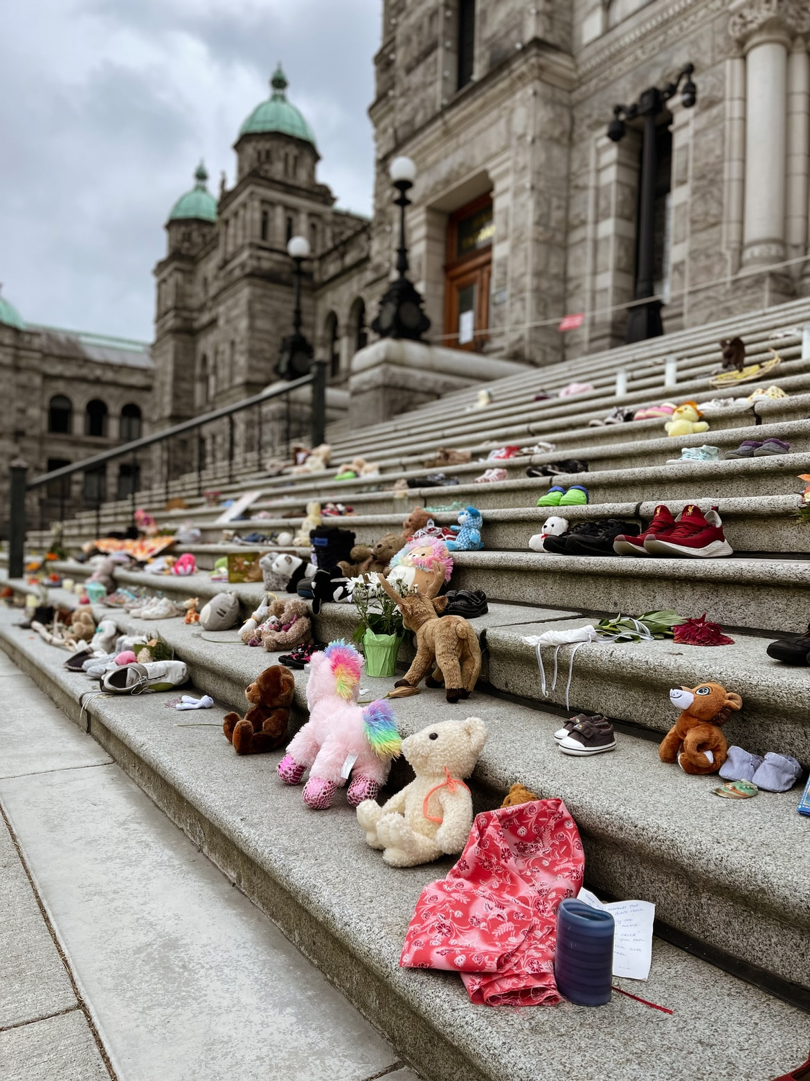 assorted plush toys on gray concrete road during daytime