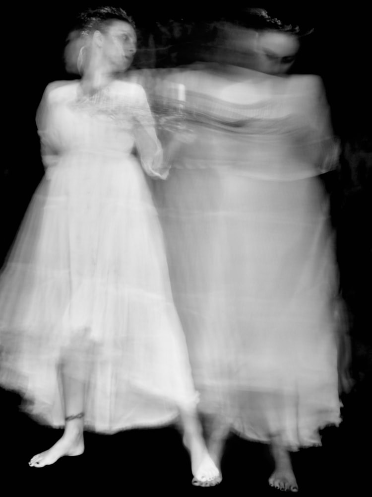 Black and white exposure of a woman in a white dress