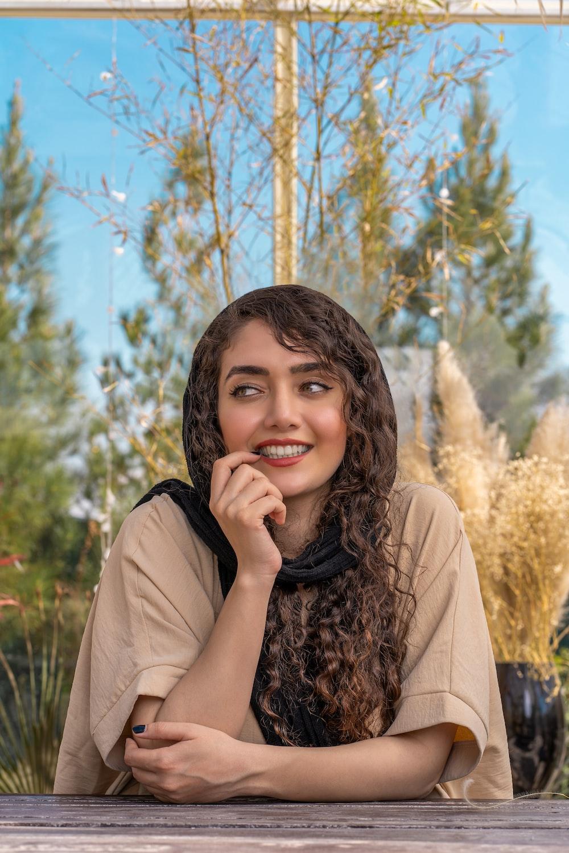 woman in brown coat smiling
