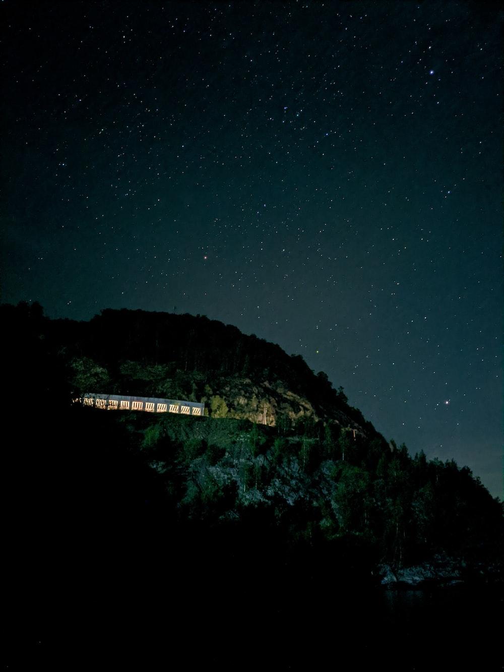 white bridge on top of mountain during night time