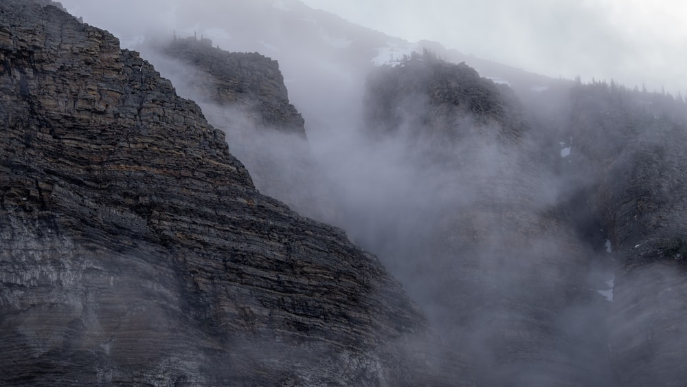brown rocky mountain with fog