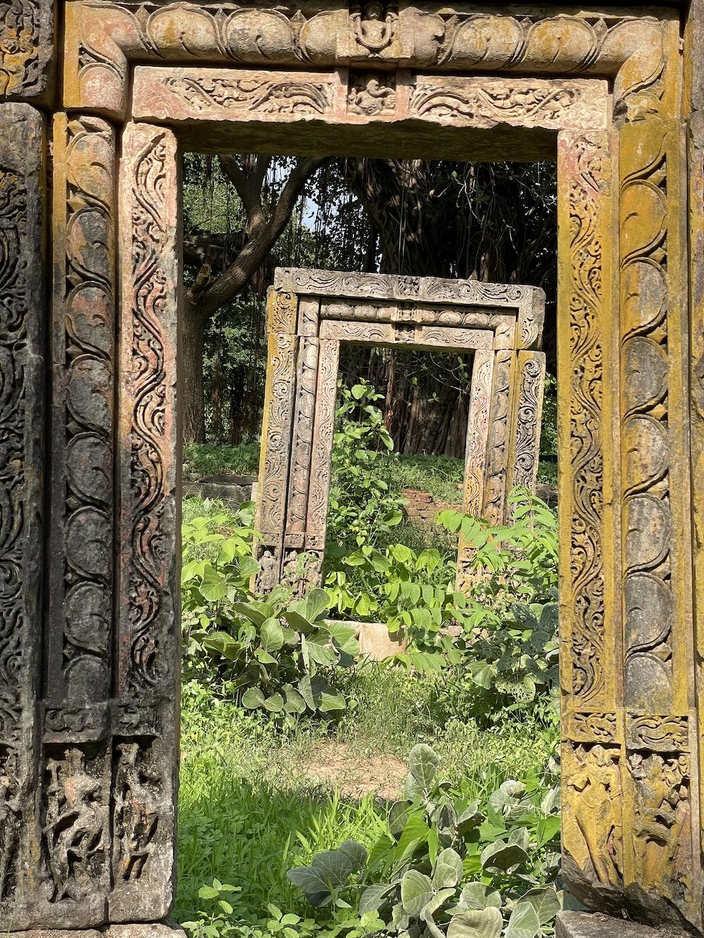 brown wooden frame on green grass