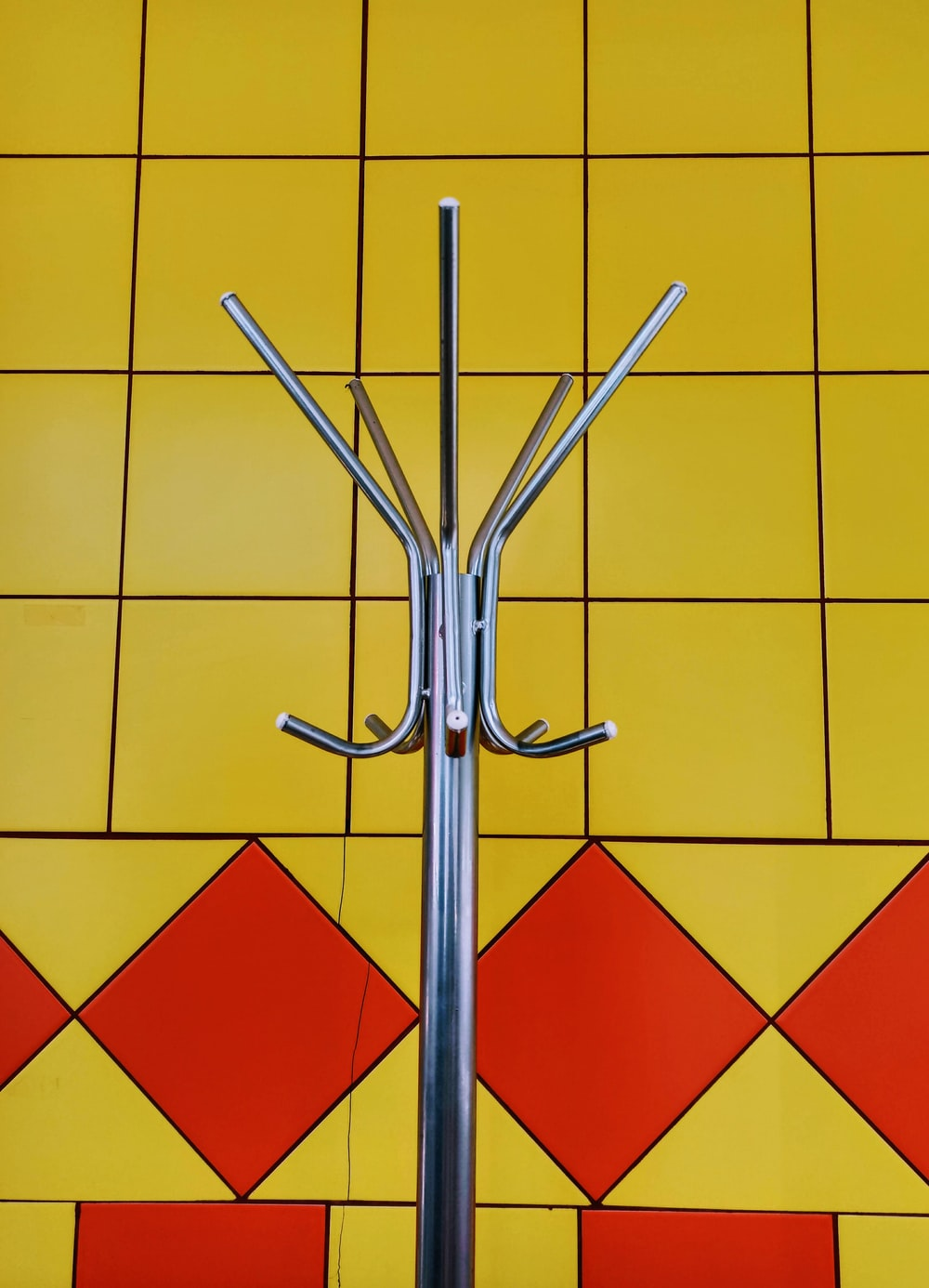 stainless steel clothes pin on white and red checkered surface