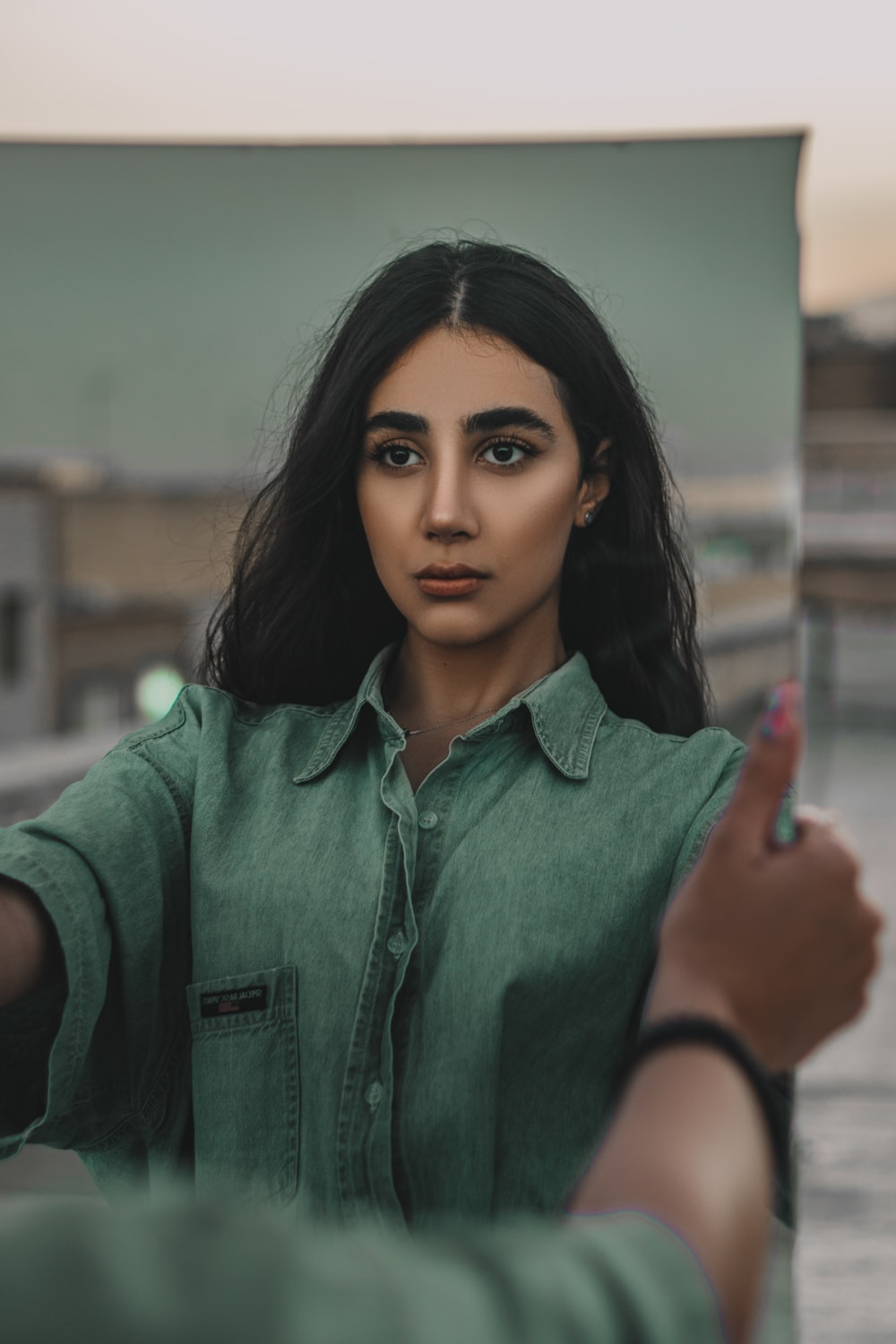 woman in green button up shirt