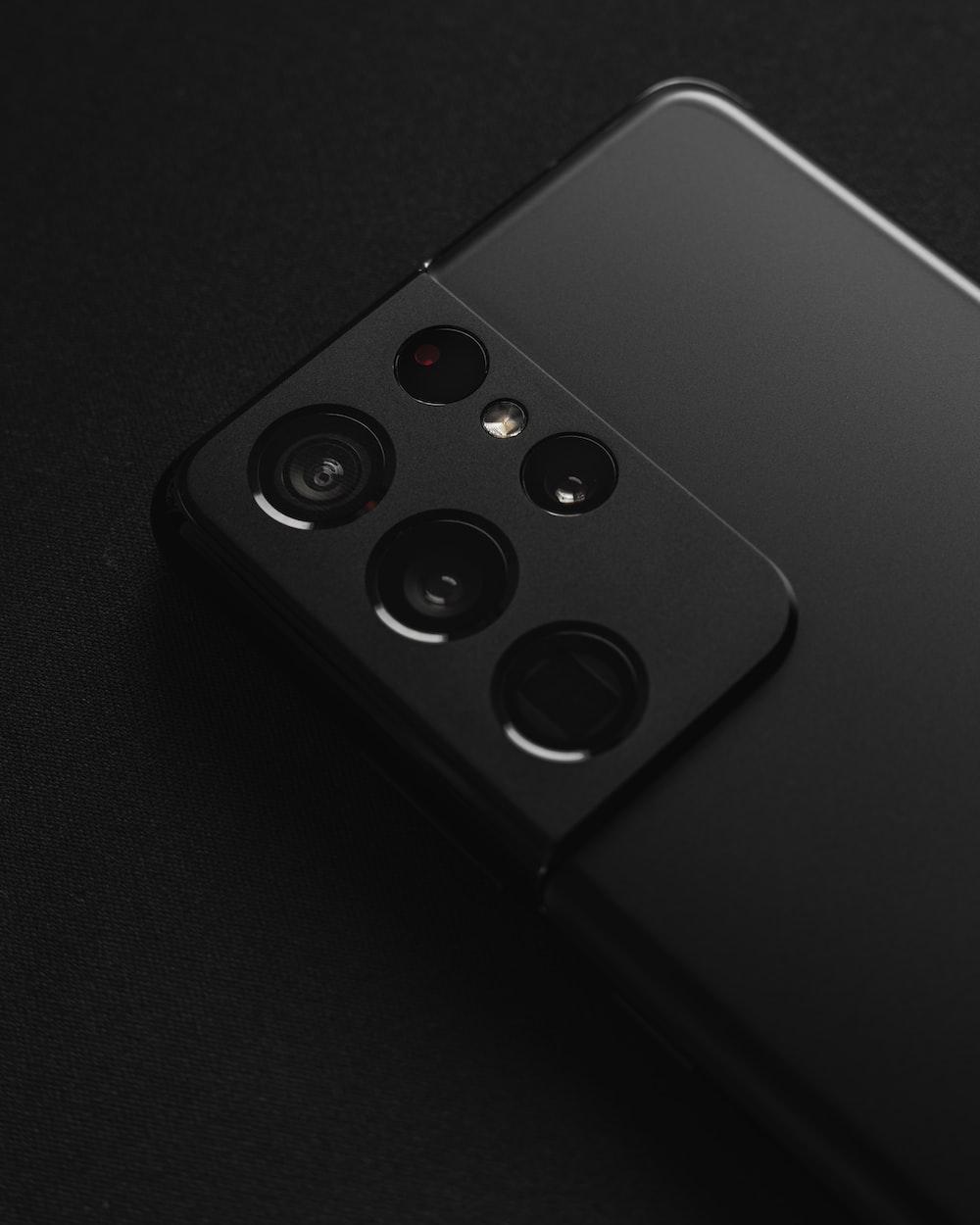 black remote control on black textile