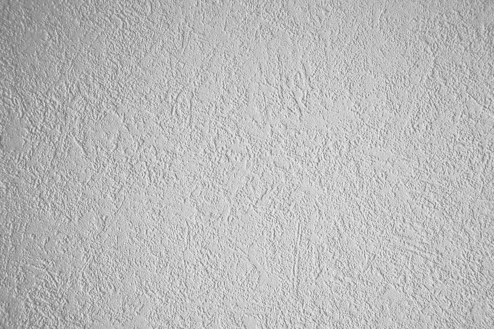 white wall paint with black round hole