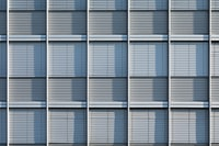 white and blue window blinds