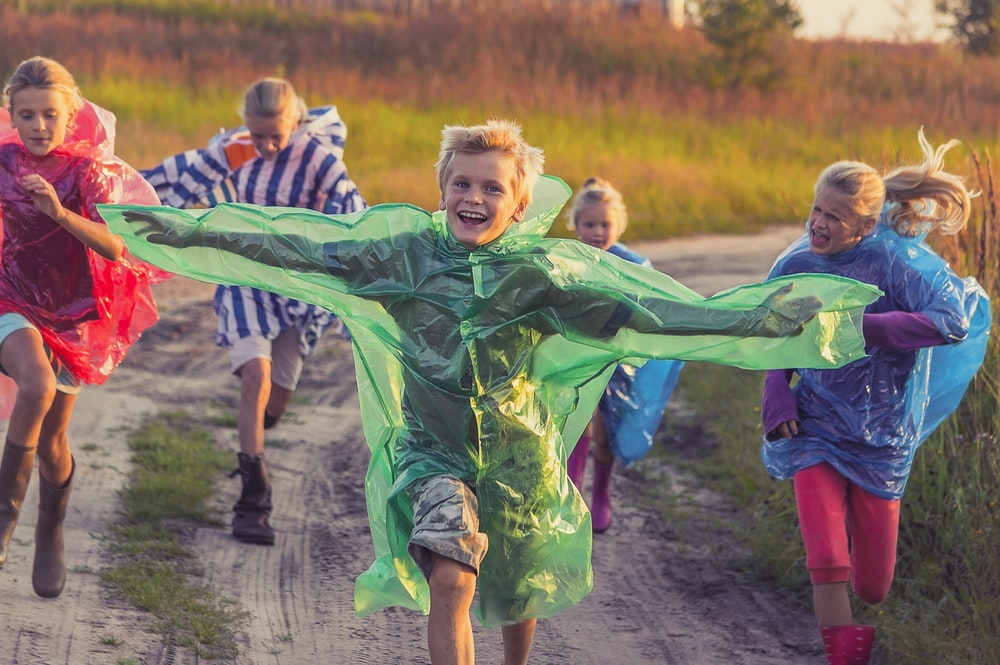 boy in green and blue jacket