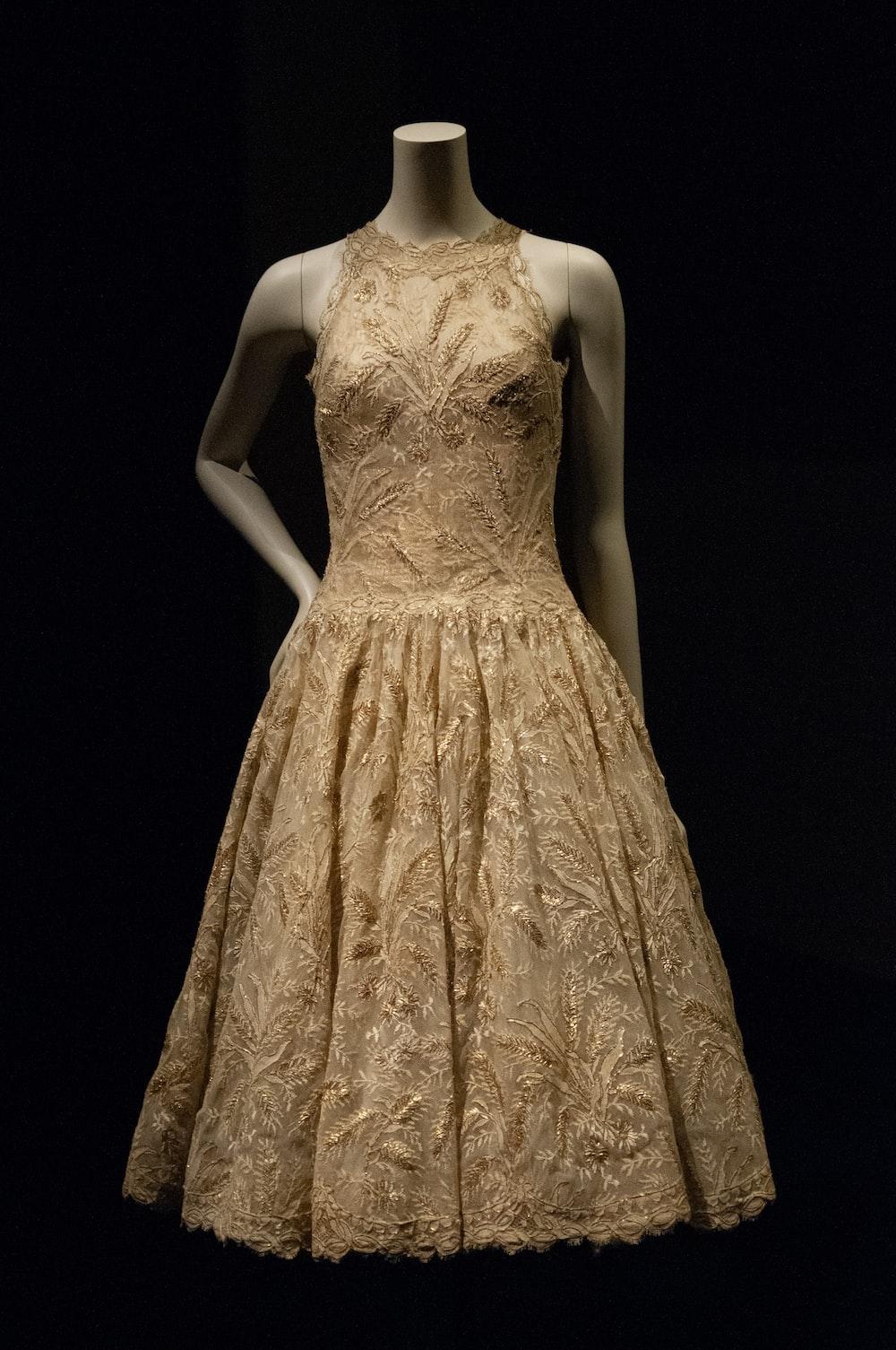 woman in beige floral sleeveless dress