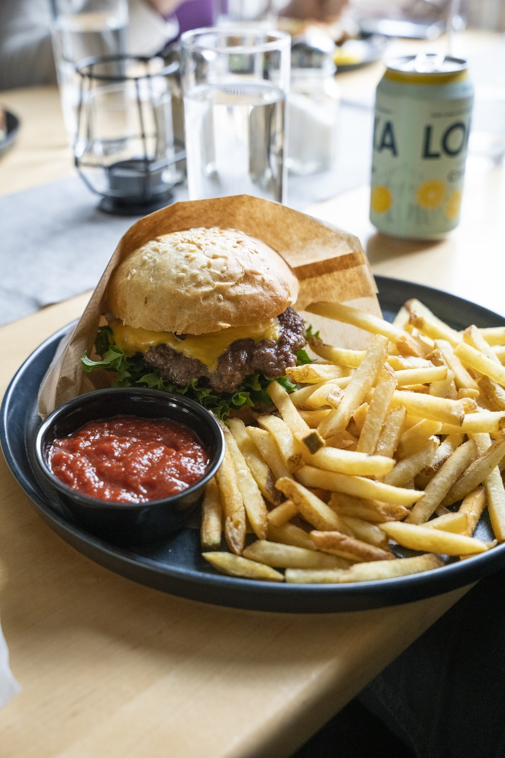 burger and fries on black plate