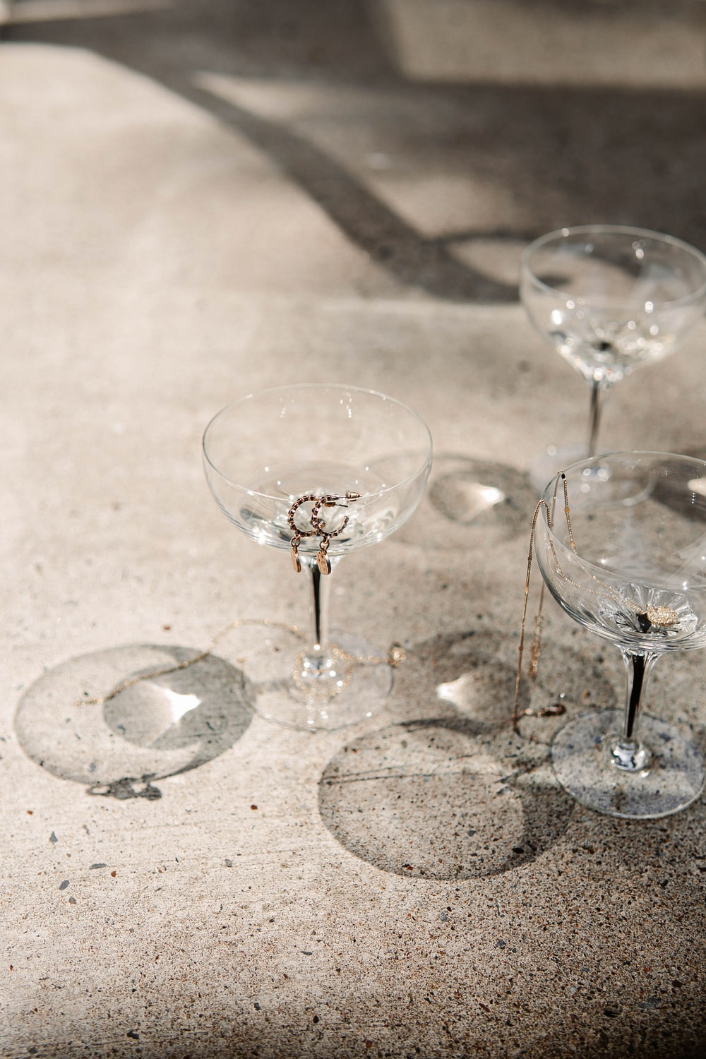 clear wine glass on white table