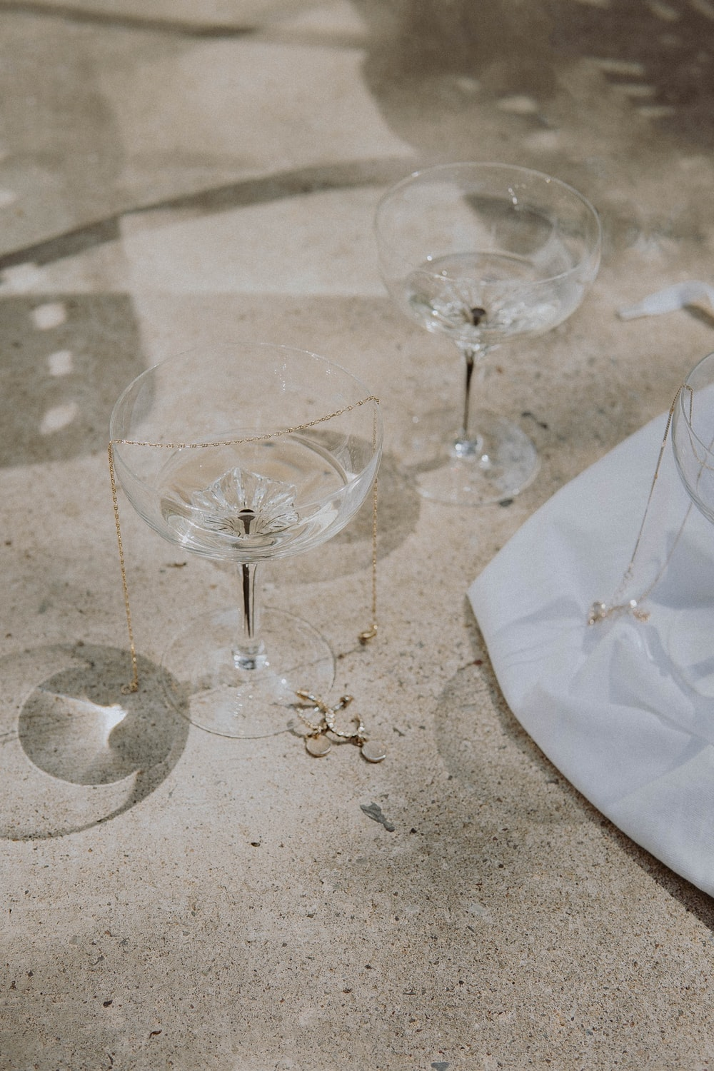 clear wine glass on white table cloth