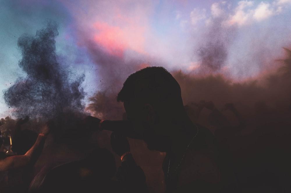 silhouette of man smoking cigarette